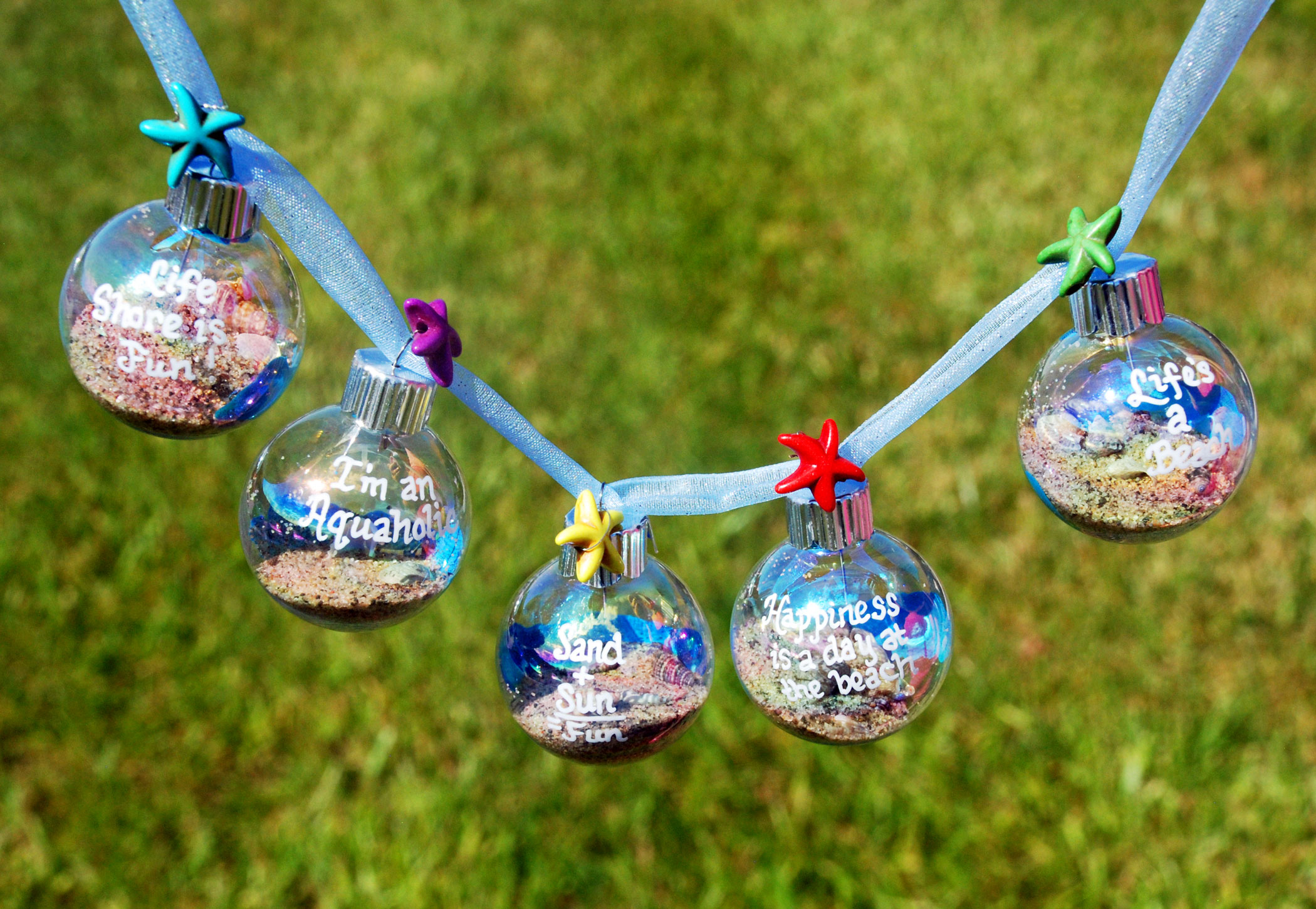 Christmas in July garland made of baubles with beach themes. | OrnamentShop.com