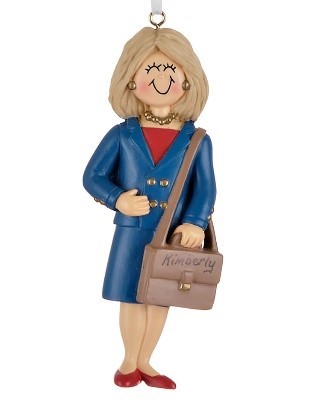 A blonde female ornament wearing a business-like navy blue dress, gold jewelry and accents, and holding a brown messenger bag | OrnamentShop