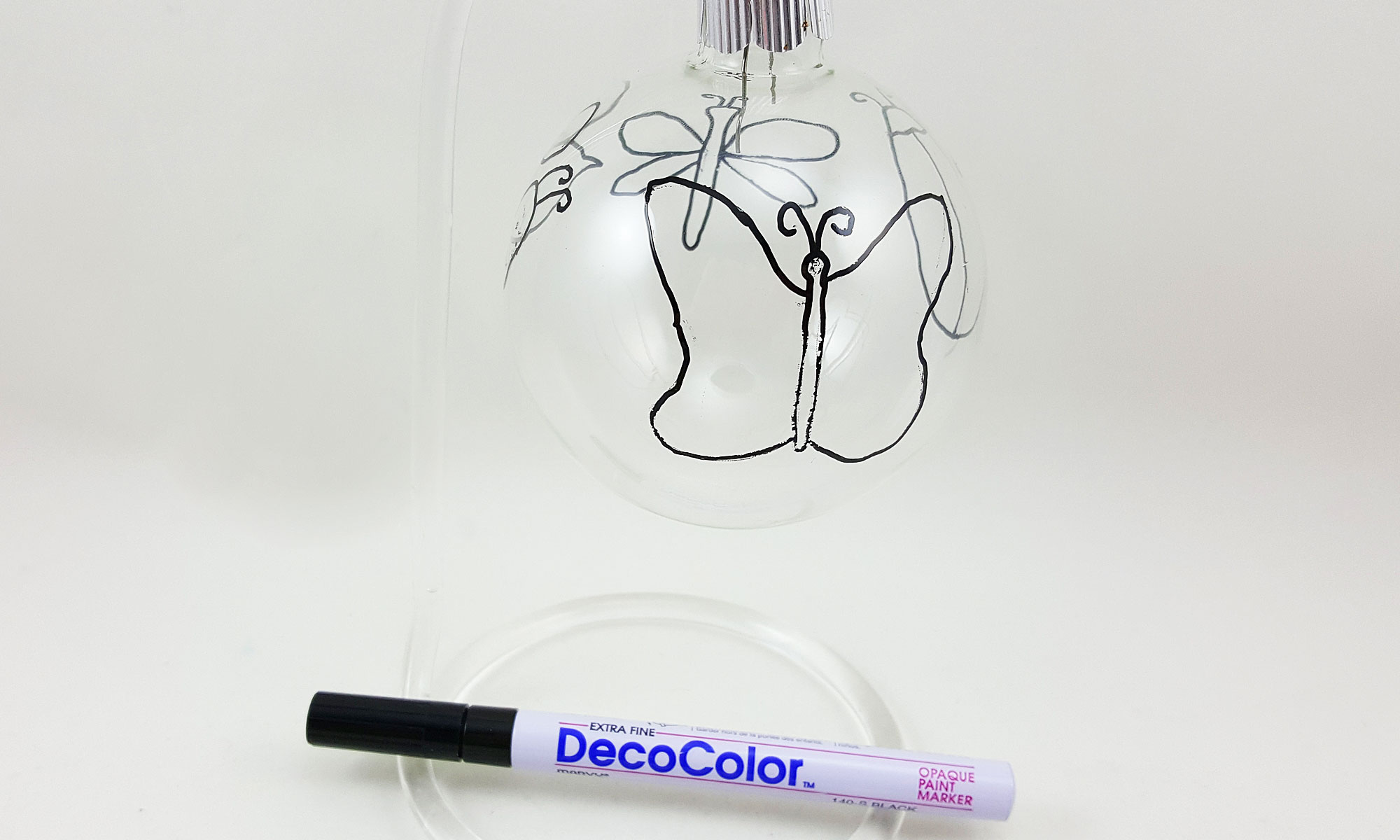 Step 1 is to outline your mosaic shapes on the clear class ball ornament | OrnamentShop.com