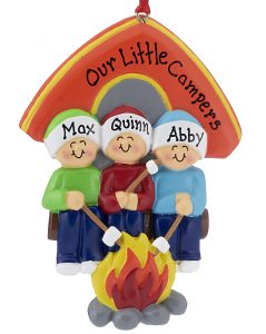 An ornament with 3 poeple sitting by a campfire roasting marshmallows in front of their tent. All can be personalized with names | OrnamentShop.com