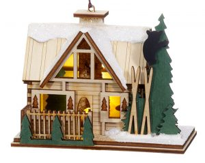 A three dimensional lodge or bed and breakfast ornament with pine trees and snow on the roof. The inside is customized with secret little scenes. | OrnamentShop.com