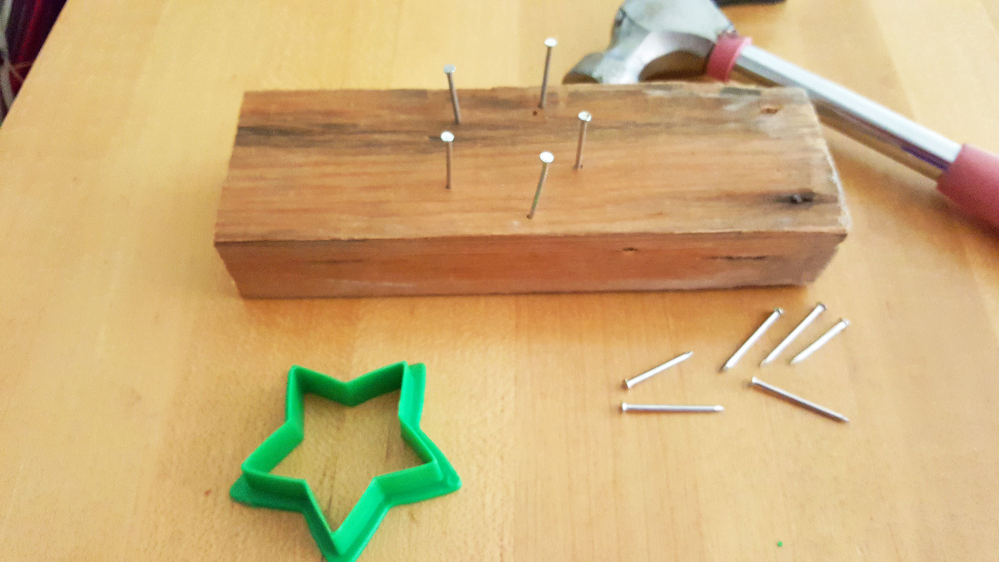 Step 2 is to remove the cookie cutter and leave the nails as a guide | OrnamentShop.com