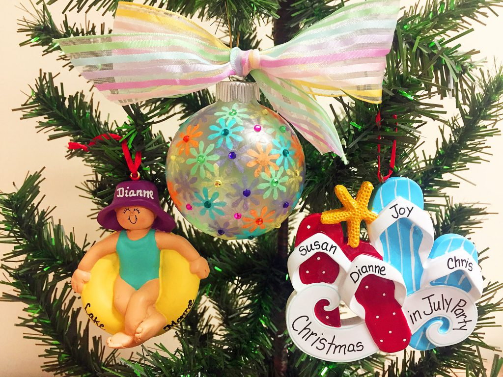 A colorful DIY ball ornament, an ornament with personalzied flipflops, and an ornament with a woman floating in a simming doughnut wearing a purple hat | OrnamentShop.com