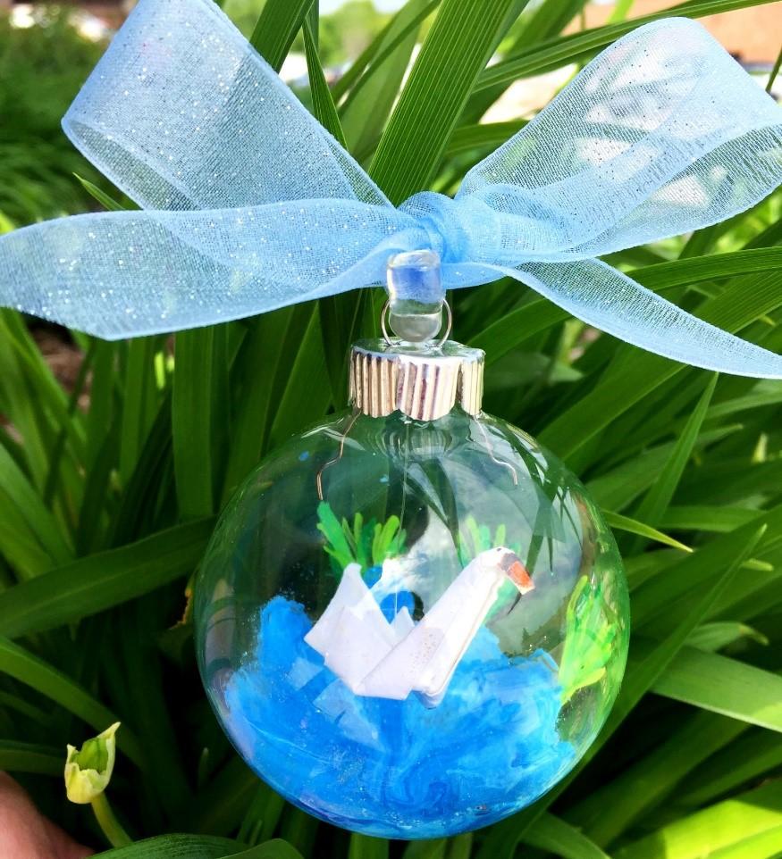 An origami swan inside of a glass ball ornament. | OrnamentShop.com