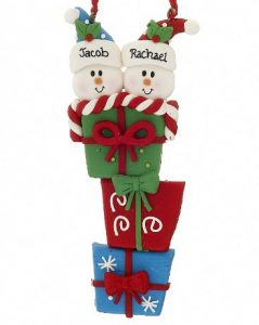 A table decoration with a stack of presents and snowmen on top. | OrnamentShop.com
