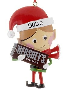 An ornament of an elf holding a giant chocolate Hershey bar. | OrnamentShop.com