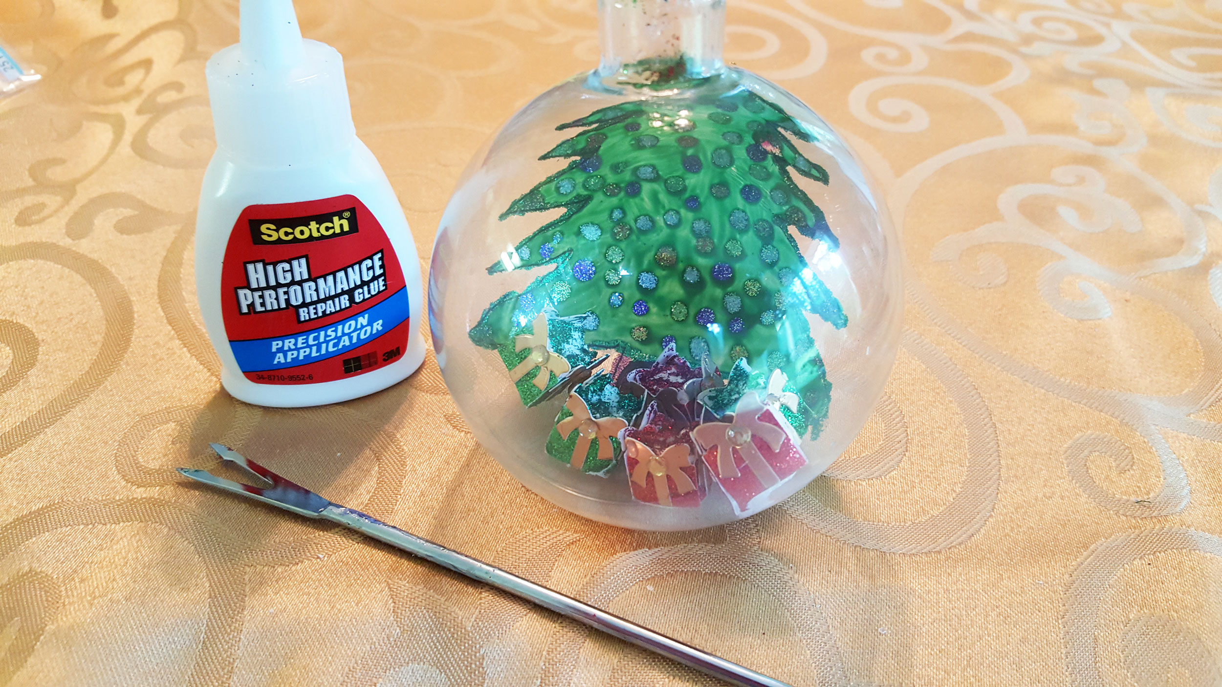 Step 5 is to use just a tiny bit of blue on the bottom of your presents while putting them in place with tweezers. | OrnamentShop.com
