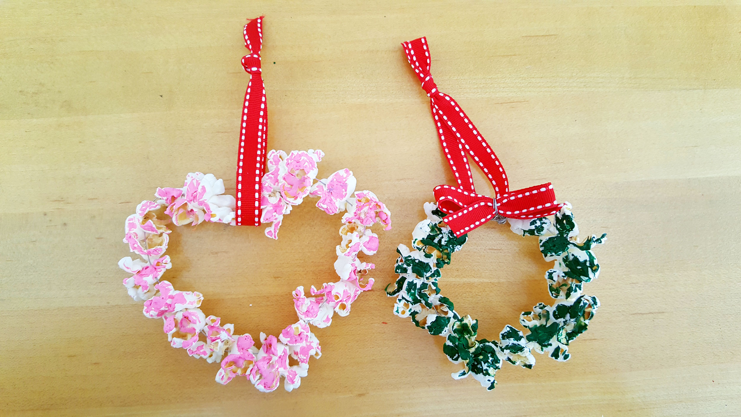 Two DIY popcorn ornaments, one shaped as a heart and the other a wreath. | OrnamentShop.com