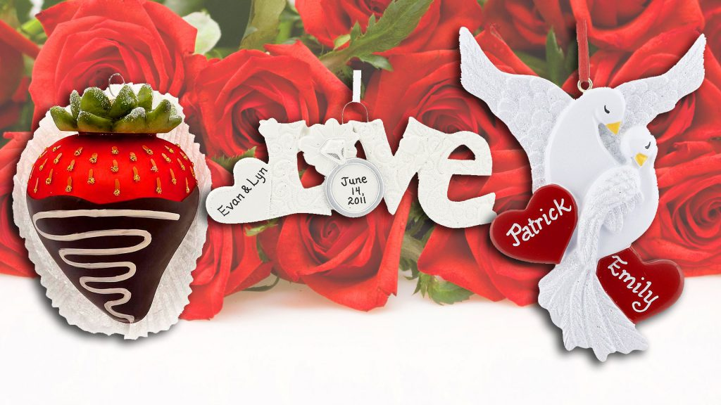 Three ornaments that represent Valentine's Day: the word Love, a dove with two hearts for names, and a chocolate covered strawberry. | OrnamentShop.com