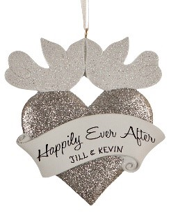 Two flat doves kiss at the top of a silver heart that reads Happily Ever After and a wedding date. | OrnamentShop.com