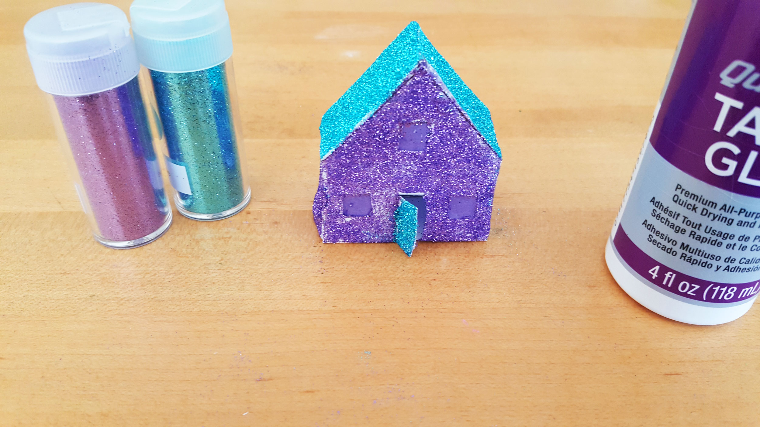 Add glue and glitters to outside of Paper House Ornament | OrnamentShop.com