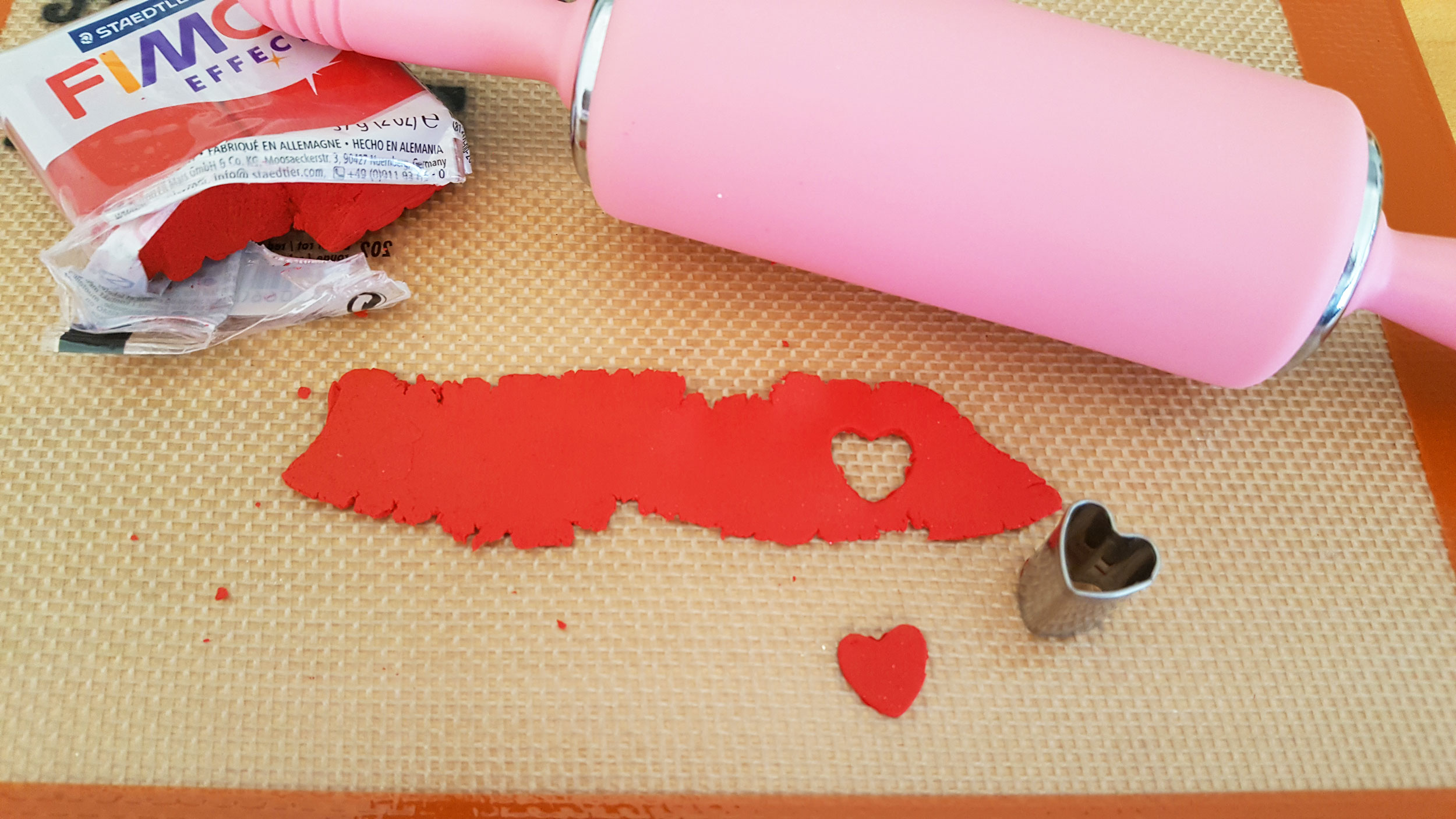 Roll and cut out red heart | OrnamentShop.com