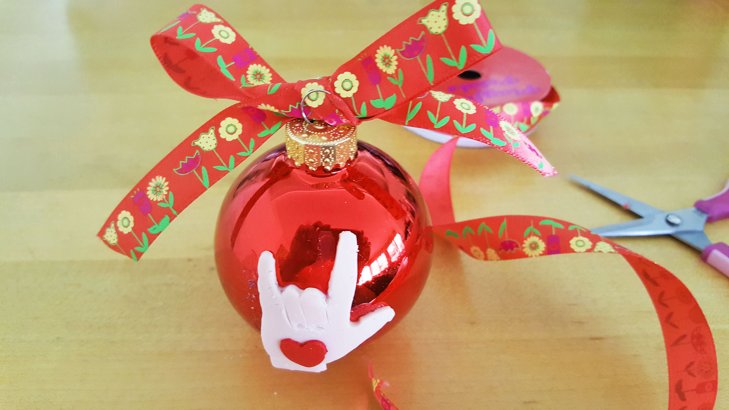 Ribbon tied on red glass ball ornament | OrnamentShop.com