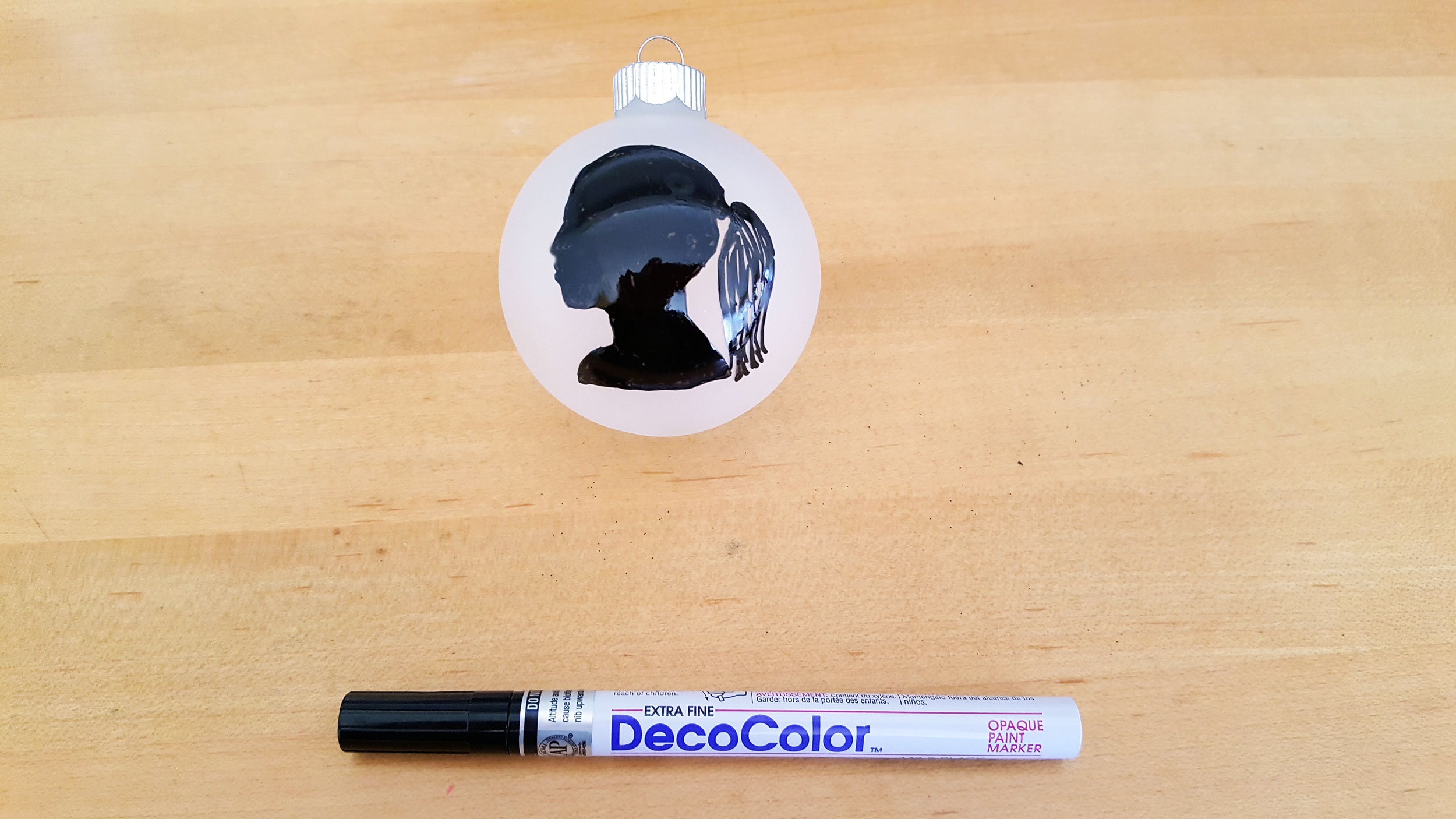 Frosted glass ball ornament with black marker outline filled in with DecoColor black marker. | OrnamentShop.com