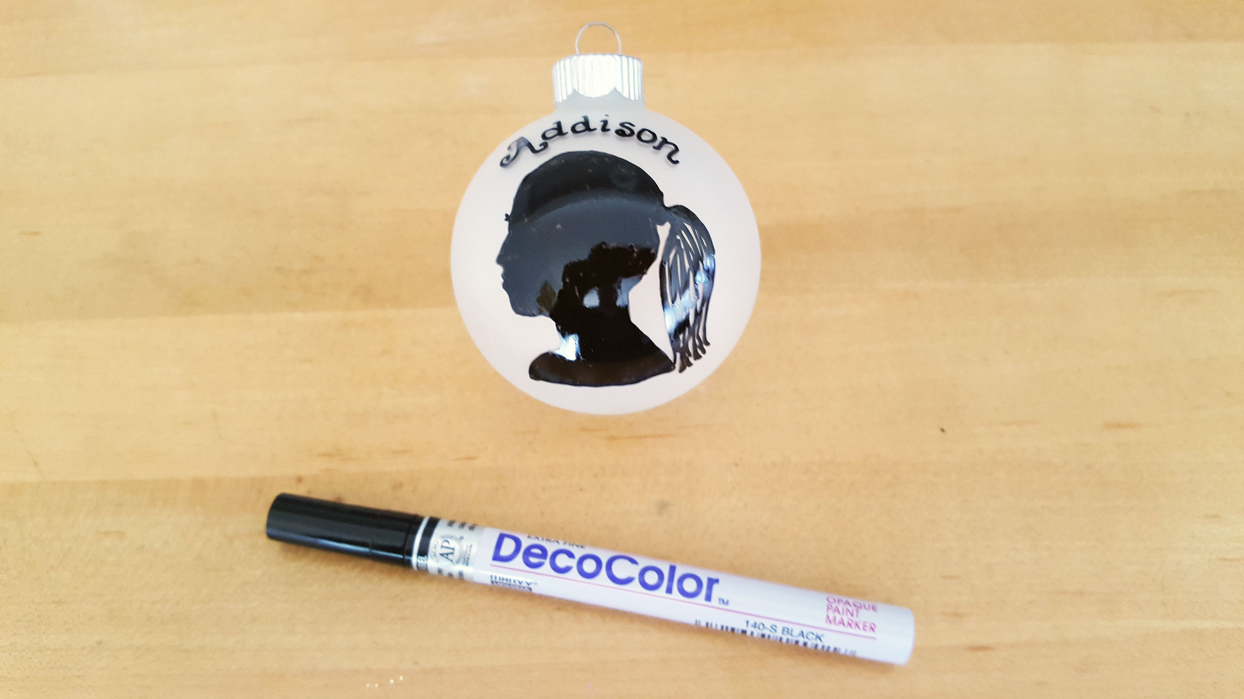 """Addison"" added to frosted glass ball ornament with black marker outline filled in with DecoColor black marker. 