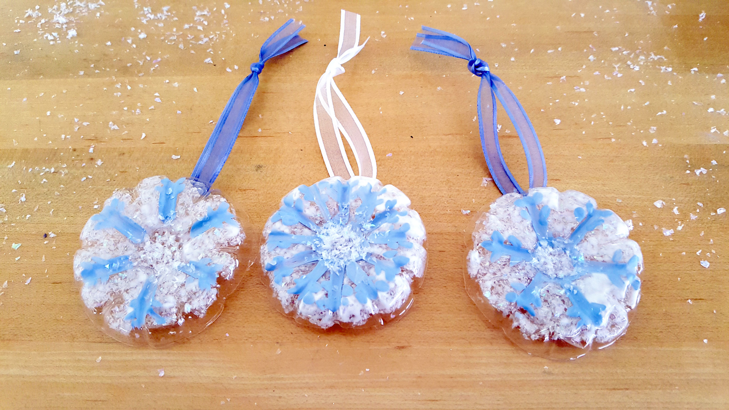 Finished Snowflake Ornaments on table. | OrnamentShop.com