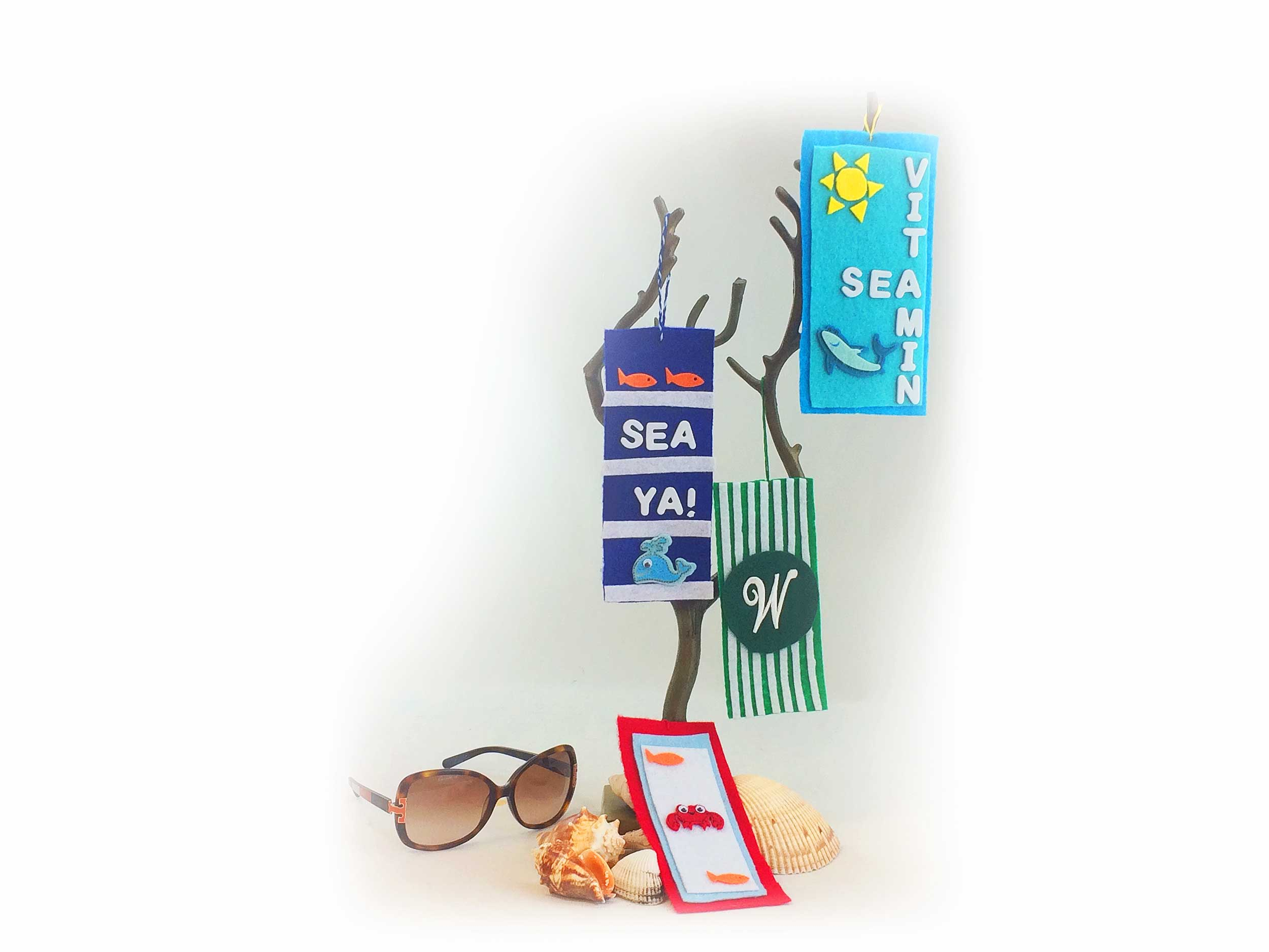 DIY beach towel ornaments on tree stand. | OrnamentShop.com