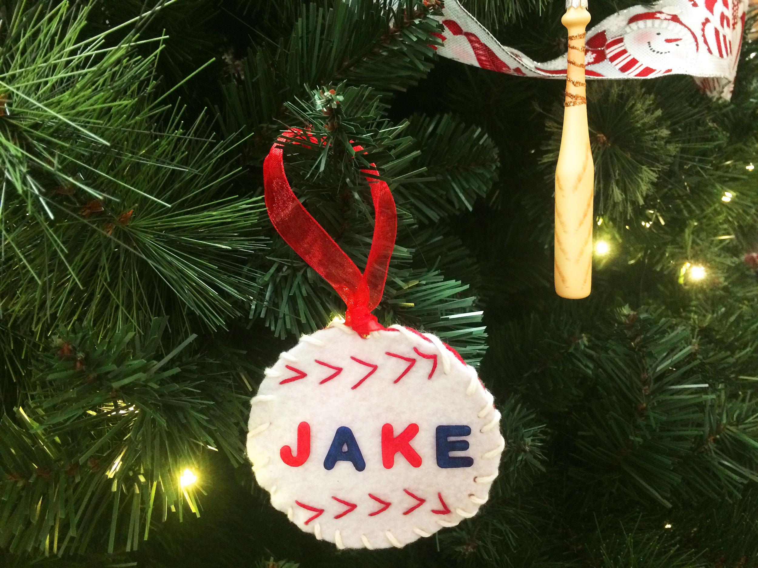 Finished DIY baseball ornament hanging on Christmas tree.   OrnamentShop.com