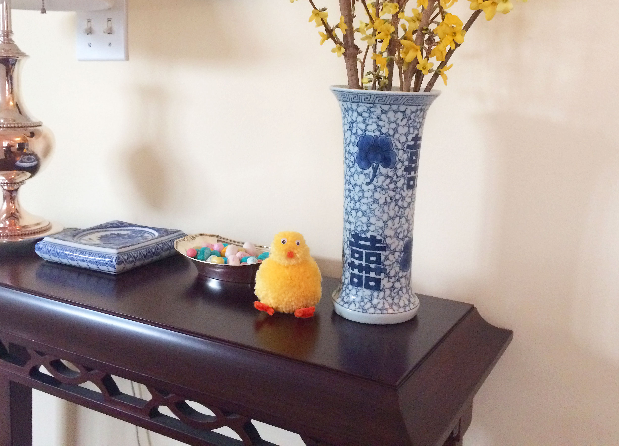 DIY Easter Chick decoration displayed on foyer console table. | OrnamentShop.com