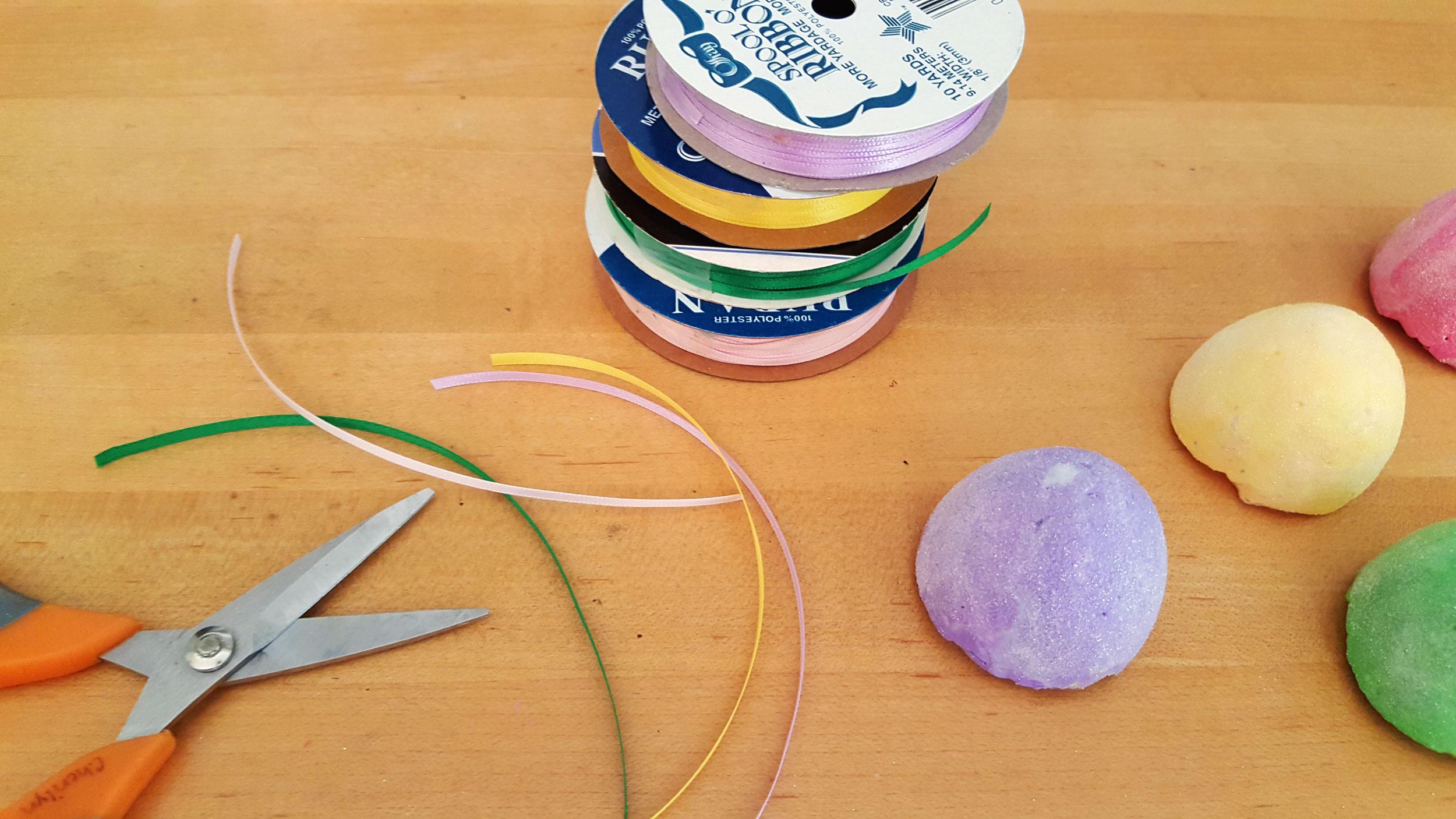 Cut colored ribbon with scissors. | OrnamentShop.com