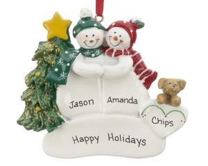 An ornament for couples with two snowmen side by side holding hands and a tan dog at their side. | OrnamentShop.com