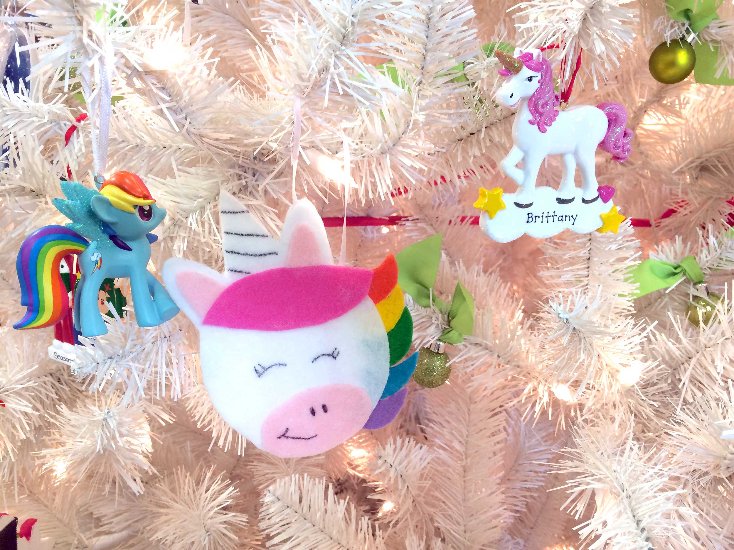 Unicorn ornaments hanging on Christmas tree | Ornament Shop