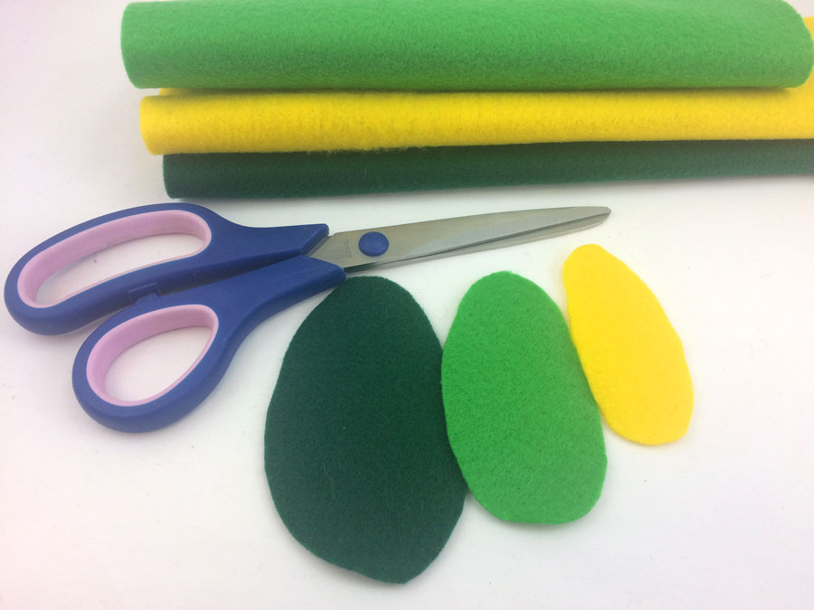 Cut avocado shapes out of dark green, light green and yellow felt | OrnamentShop.com